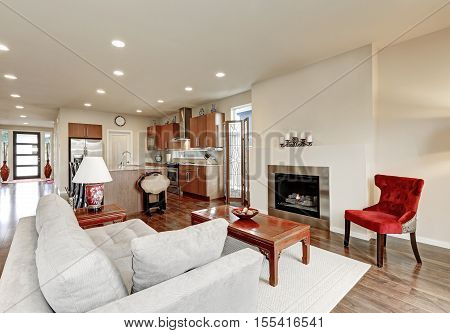 Typical American Family Room Interior In Light Tones