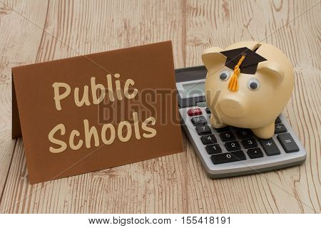 Saving on education by attending public schools A golden piggy bank with grad cap on a calculator on a desk with text Public Schools