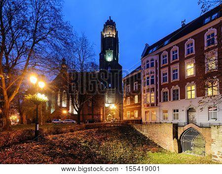 Autumn square near the Church in Gliwice. Europe in the evening.
