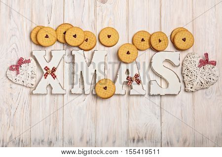 Merry Christmas! Cookies with jam hearts and wooden letters XMAS.