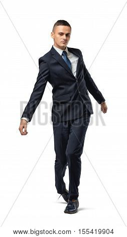Full body of businessman walking with uncertain gait, isolated on a white background. Laxity and irresponsibility. To go with the flow. The unstable situation in the workplace.