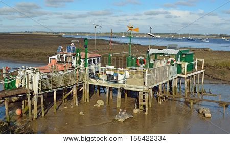 FELIXSTOWE, SUFFOLK, ENGLAND - NOVEMBER 06, 2016: Houseboat Dwelling in the mud flats near the estuary of the river Deben Suffolk.