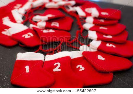 red and white mini Christmas stocking as Christmas calendar