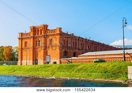 ST PETERSBURG RUSSIA - OCTOBER 3 2016. Building of Military Historical Museum of Artillery Engineers and Signal Corps and military weapon exhibits in the open air in St Petersburg Russia