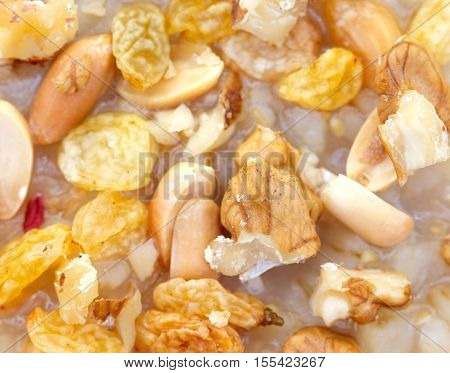 picture of a walnuts raisins and peanuts in aTurkish traditional dessert ashure (Noah's Pudding)