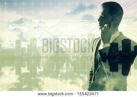 Backlit side portrait of handsome young businessman talking on mobile phone on abstract city background with copy space and mesh. Double exposure. Communication concept