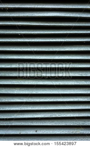 antique wooden blinds of gray color for the background. striped texture.