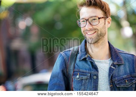 Cheerful man walking in the street, NYC tour