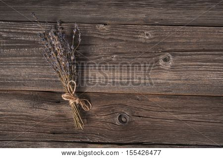 Top view of decorative lavender bouquet on wooden background