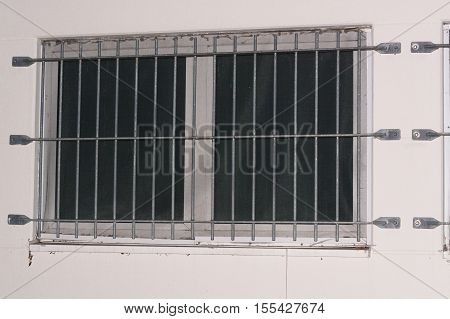 Installation of window grid of metal as protection against intruders. Security grille for windows doors and balconies.