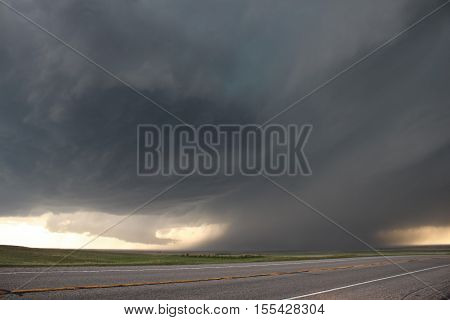An intense supercell thunderstorm glides over the high plains of eastern Colorado in the springtime.