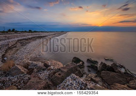 sunrise at sea on a rocky shore. Black Sea Romania
