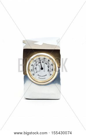 Gift thermometer in a metal case on a white background.