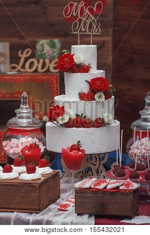 Beautiful wedding cake with strawberry and decoration of the hall
