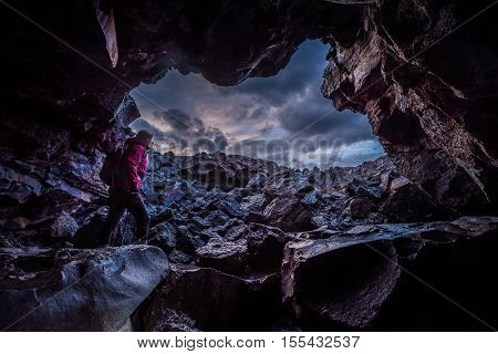 Woman Exploring Dewdrop Cave Craters Of The Moon National Idaho