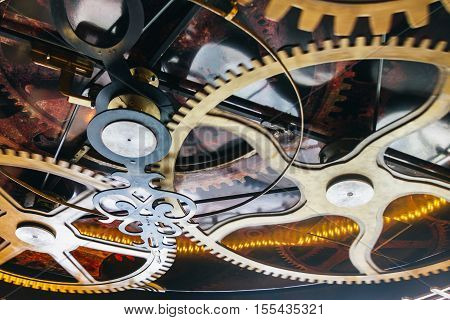Fake clockwork with gears in motion and sunlight