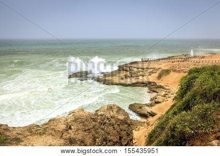 Blow holes area at Al Mughsayl beach near Salalah, Oman during monsoon season