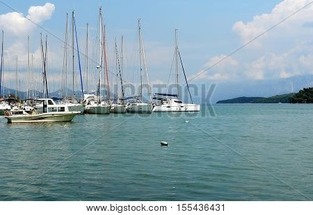 Nidri GREECE May 11 2013: Landscape with green island mountains and yachts in Ionian sea Greece.
