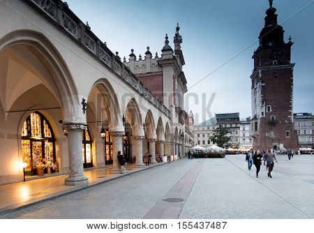 Krakow Poland - October 2 2016: Main market square of Cracow in soft light of sunrise vie of St. Mary cathedral. Krakow Rynek Glowny Bazylika Mariacka