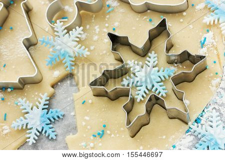 Christmas cookie preparation - raw dough and cookie cutters