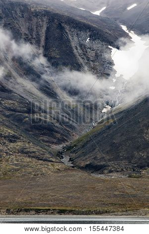 fog in the harsh Northern coastal cliffs in the North of Russia in Chukotka