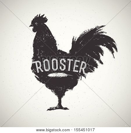 Graphic silhouette of a rooster and inscription.