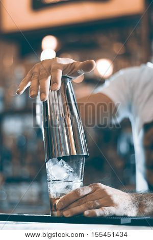 Expert Barman Is Making Cocktail At Night Club Cocktail Shaker.