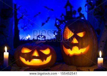 Halloween pumpkins and autumn leaves. Halloween pumpkin lanterns.