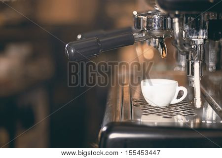 Coffee Espresso. Espresso Machine Making Coffee, Golden Espresso Flowing.