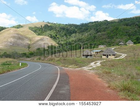 Bifurcation route to enter small village in the great Venezuelan savannah