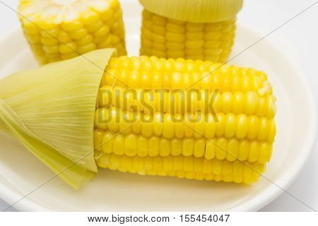 Boiled corn on a plate, Boiled corn on white background.