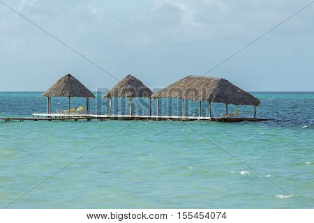 nice amazing view of old wooden pier looks like floating in tranquil ocean high tide