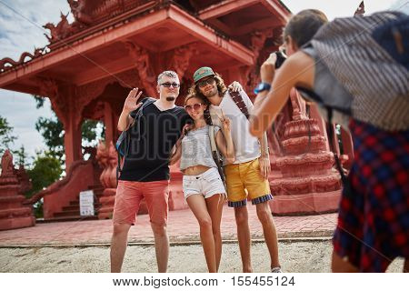taking group photo in front of temple in thailand