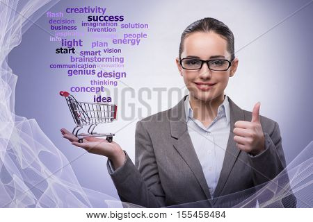 Young businesswoman with shopping cart