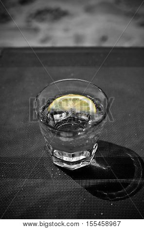 Cool Soda Water Tonic or Votka with Lemon and Ice black and white tones