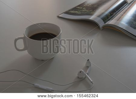 morning coffee White cup on White wooden table. , light and Shadow