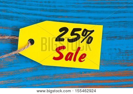 sale minus 25 percent. Big sales twenty five percents on blue wooden background for flyer, poster, shopping, sign, discount, marketing, selling, banner, web