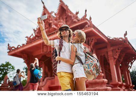 tourists taking photos at temple on koh samui thailand