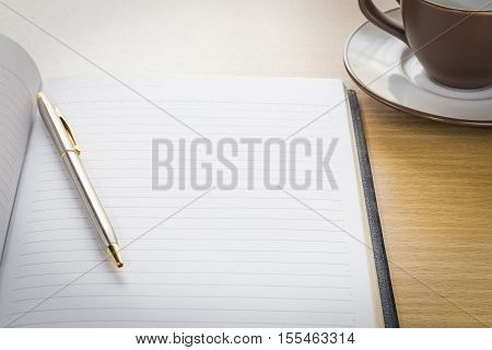 Pen And Notebook Open Blank Page