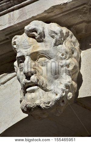 Characteristic baroque stone head decoration very common in Venice
