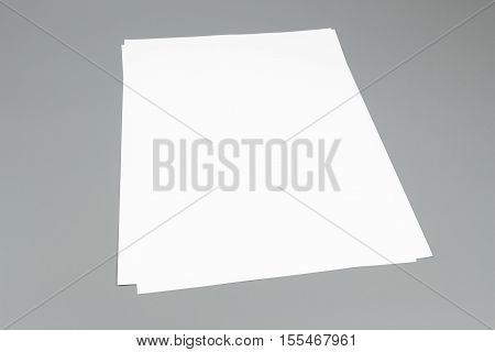 Blank portrait A4, white paper isolated on gray