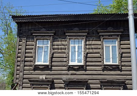 A Two-storey Wooden House With Carved Ornaments
