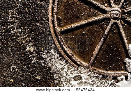 Manhole, manhole cover, manhole under snow, winter, grunge background, first snow, early winter