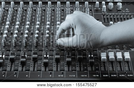 Live Sound Mixers and music studio equalizer, equip, event hand