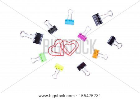 Heart paperclips in center surround with multicolored paperclip binders.