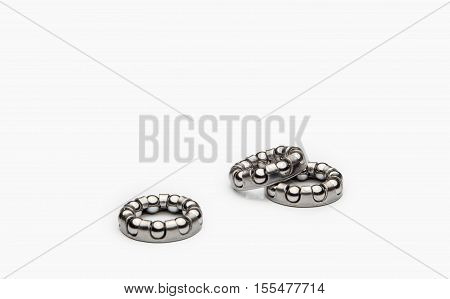 Three bicycle bearings on a white background