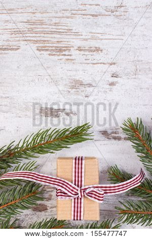 Wrapped Gift And Spruce Branches For Christmas Or Valentines