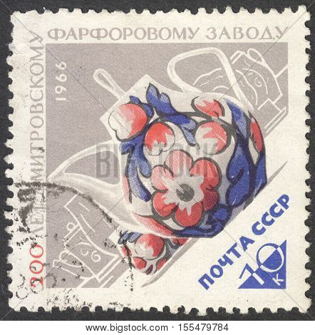 MOSCOW RUSSIA - CIRCA OCTOBER 2016: a post stamp printed in the USSR shows a tea set the series