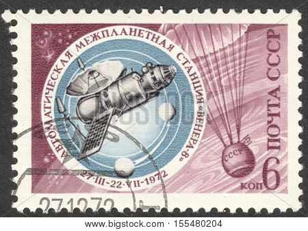MOSCOW RUSSIA - CIRCA OCTOBER 2016: a post stamp printed in the USSR shows the Venera 8 and Parachute dedicated to Space Exploration circa 1972