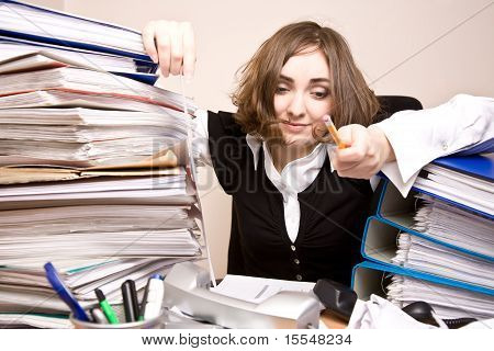 Tired Businesswoman With A Lot Of Folders